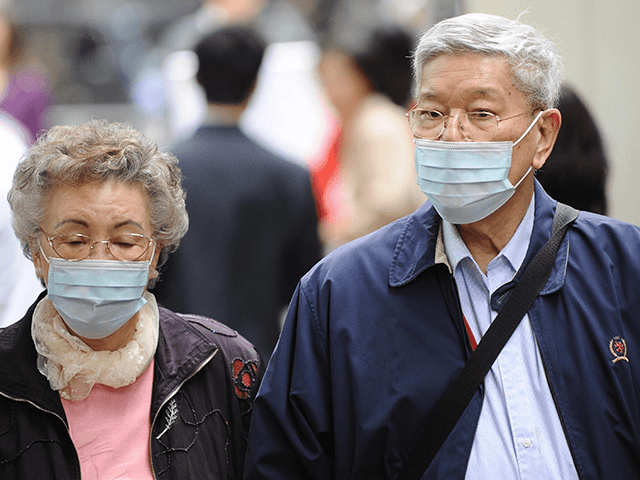 An elderly couple wearing protective mask walk along a street in Hong Kong on March 14, 2008 two days after authorities shut down primary schools due to flu outbreak. Hong Kong health authorities tried March 13 to calm public fears over a flu outbreak which has left four children dead …