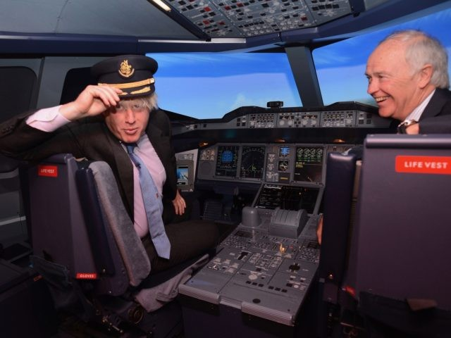 London Mayor Boris Johnson and Emirates Airlines President Tim Clark at the launch of the Emirates Aviation Experience in Greenwich today where visitors will be able to sit at the controls of an Airbus A380 flight simulator. (Photo by Stefan Rousseau/PA Images via Getty Images)