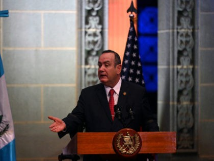 """Guatemalan President Alejandro Giammattei speaks during a joint press conference with US Vice-President Kamala Harris (out of frame) at the Culture Palace in Guatemala City on June 7, 2021. - Harris arrived in Guatemala Sunday, bringing a message of """"hope"""" to a region hammered by Covid-19 and which is the …"""