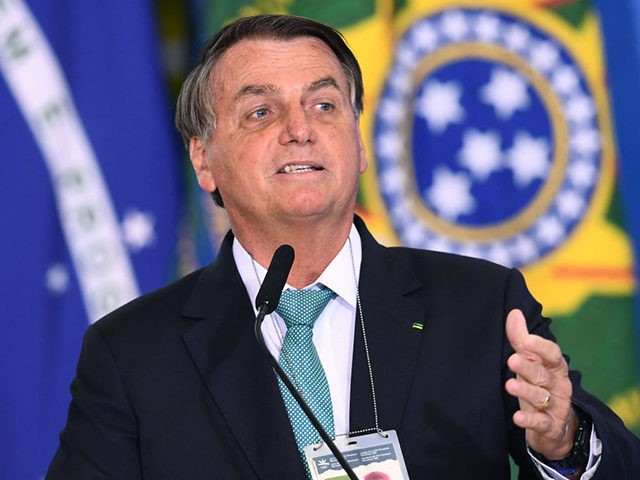 Brazilian President Jair Bolsonaro delivers a speech during the announcement of sponsorship of olympic sports team by the state bank Caixa Economica Federal at Planalto Palace on June 1, 2021. - Brazil's President Jair Bolsonaro said on Tuesday that, if it depends on his government, his country will host the …