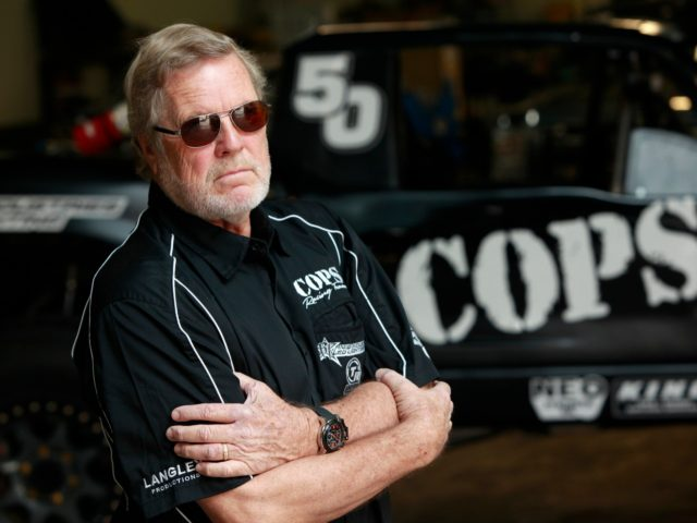 EL SEGUNDO, CA - NOVEMBER 01: SCORE International CEO Saul Fish (not pictured) gives Cops Racing Team owner (and former Baja 1000 winner) John Langley a preview of the watch at Cops Racing on November 1, 2012 in El Segundo, California. GRAHAM WATCHES, one of the world's finest watch companies, …