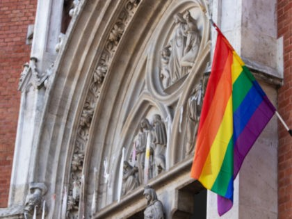 A LGBT rainbow flag hangs outside St Elizabeth Church in Wieden, Vienna, on March 25, 2021. - As a protest against the decision of the Vatican Congregation for the Doctrine of the Faith to bless homosexual partnerships, two Viennese churches display the rainbow flag. - TO GO WITH AFP STORY …