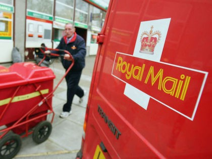 LONDON - NOVEMBER 1: A Royal Mail worker delivers mail ouside of a high street Post Office on November 1, 2004 in London, England. The Royal Mail has dampened down reports that it is too close or sell between 240 and 270 of its larger high street branches which are …