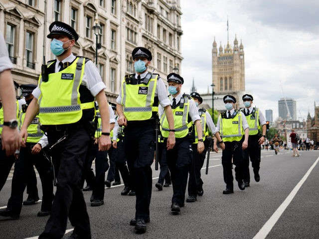 Police officers patrol the streets of Westminster as protesters gather for a demonstration against government lockdown restrictions in central London on June 14, 2021. - Britain was on Monday widely expected to delay the full lifting of coronavirus restrictions due to a surge of infections caused by the Delta variant. …