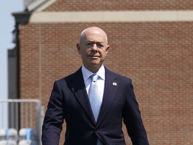 Homeland Security Secretary Alejandro Mayorkas arrives for the commencement for the United States Coast Guard Academy in New London, Conn., Wednesday, May 19, 2021. (AP Photo/Andrew Harnik)
