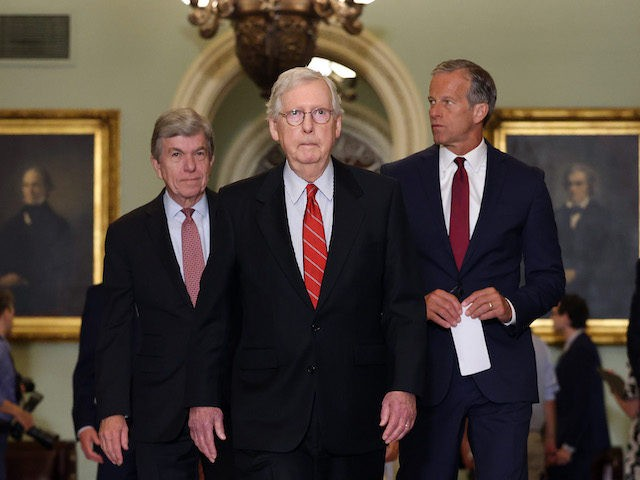 WASHINGTON, DC - JUNE 15: Senate Minority Leader Mitch McConnell (R-KY) (C) walks with U.S. Sen. Roy Blunt (L) (R-MO) and U.S. Sen. John Thune (R-SD) as they leave a Republican Senate luncheon at the U.S. Capitol Building on June 15, 2021 in Washington, DC. The Senate is in negotiations …