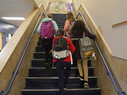 Students arrive for school at Freedom Preparatory Academy on February 10, 2021 in Provo, Utah. Freedom Academy has done in person instruction since the middle of August of 2020 with only four days of school canceled due to COVID-19 outbreak. (Photo by George Frey/Getty Images)