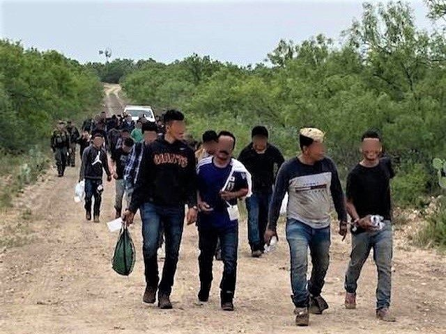 Uvalde Station Border Patrol agents apprehend a large group of migrants in May. (Photo: U.S. Border Patrol/Del Rio Sector)