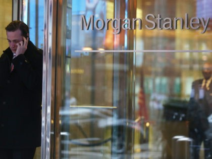"""NEW YORK, NY - JANUARY 09: A man walks out of Morgan Stanley headquarters in Manhattan on January 9, 2013 in New York City. Morgan Stanley announced plans to cut 1,600 jobs, or 6 percent of its workforce, due to """"market conditions"""". (Photo by Mario Tama/Getty Images)"""
