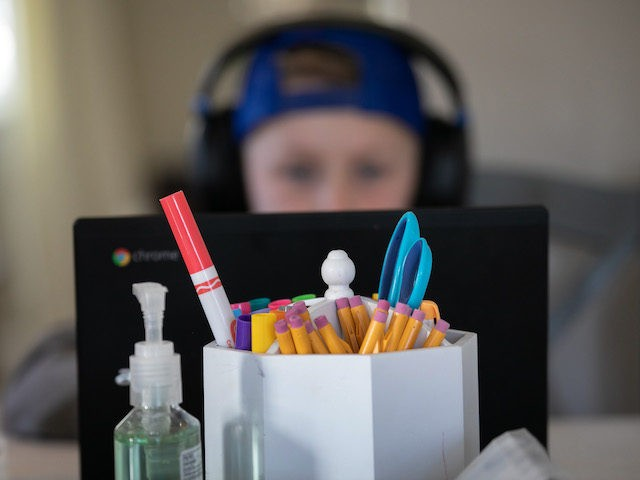 Cam Eaton, 9, works on a Chromebook during home schooling on March 18, 2020 in New Rochelle, New York. Schools in New Rochelle, a hot spot in the U.S. for the coronavirus (COVID-19) pandemic, were suspended on March 13, and parents have been tasked with carrying out distance learning programs …