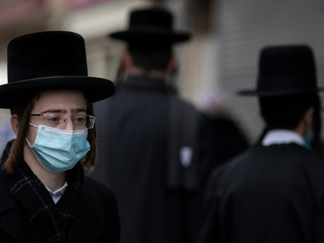 LONDON, ENGLAND - FEBRUARY 25: Members of the Orthodox Jewish community in Stamford Hill, ahead of Purim on February 25, 2021 in London, England. Last year's Purim occurred before the first Coronavirus lockdown came into force. This year the celebration will be scaled back significantly, with Rabbis asking that, among …