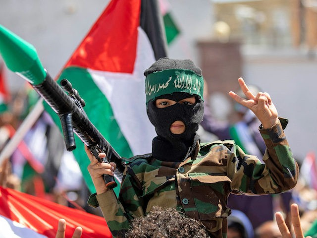 """A Yemeni boy holds a mockup rocket during a demonstration in Yemen's third city Taez on May 22, 2021 celebrating """"the victory of the Palestinian resistance"""" against Israel following a ceasefire. - A ceasefire was announced on May 20 between Israel and Palestinian armed groups, including the Islamist movement Hamas, …"""