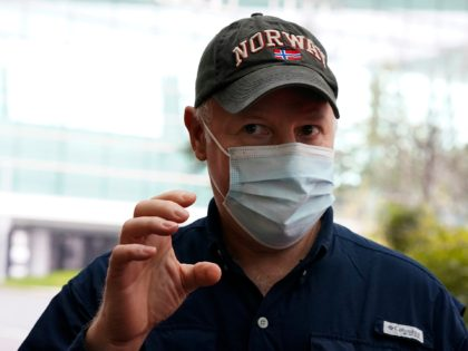 Peter Daszak of the World Health Organization team speaks to journalists before entering the VIP terminal of the airport to leave at the end of the WHO mission in Wuhan in central China's Hubei province on Wednesday, Feb. 10, 2021. (AP Photo/Ng Han Guan)