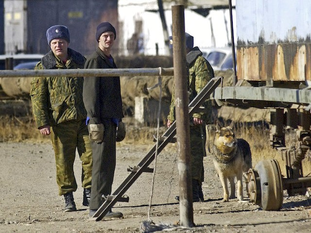 In this file photo taken on Monday, Oct. 31, 2005, Guards and an unidentified inmate stand near the entrance to the prohibited area around the prison in the town of Krasnokamensk in Siberia's Chita region near the Chinese border, Russia. A hunger strike by jailed Russian opposition leader Alexei Navalny …