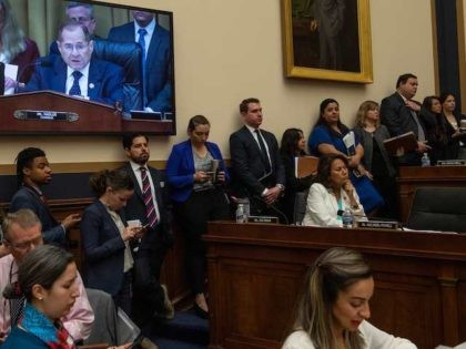 Journalists and staffers listen to Chairman of the House Judiciary Committee, Jerry Nadler (on screen), speak during a markup of a resolution supporting the committee report on Attorney General William Barr's failure to produce the unredacted Mueller report and underlying materials on Capitol Hill in Washington, DC, on May 8, …