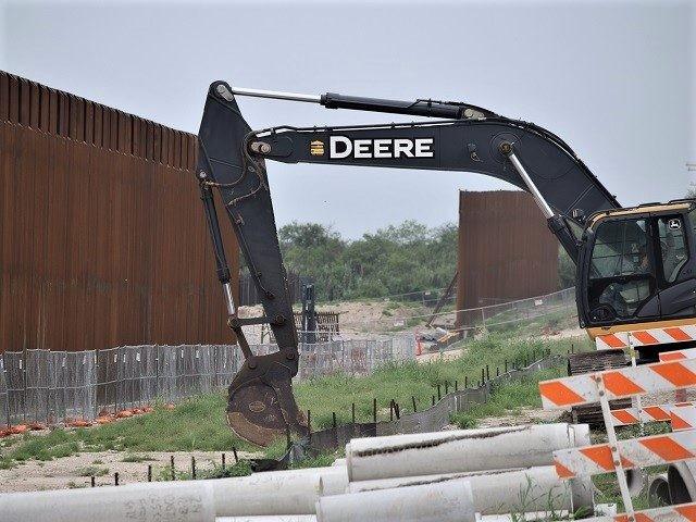 Construction crews work on dismantling Trump's Border Wall near Del Rio, Texas in June 2021. (Photo: Bob Price/Breitbart Texas)