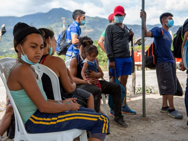 Detained Honduran migrants wait at a police checkpoint to be returned by buses to El Florido, one of the border points between Guatemala and Honduras, near Zacapa, Guatemala, Wednesday, Jan. 20, 2021. A once large caravan of Honduran migrants that pushed its way into Guatemala last week in hopes of …