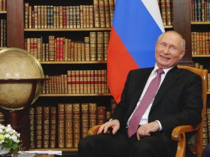 Vladimir Putin globe (Denis Balibouse / Pool / AFP / Getty)