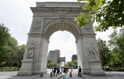 Pedestrians pass the Arch at Washington Square Park Monday, May 20, 2013, in New York. (AP Photo/Frank Franklin II)