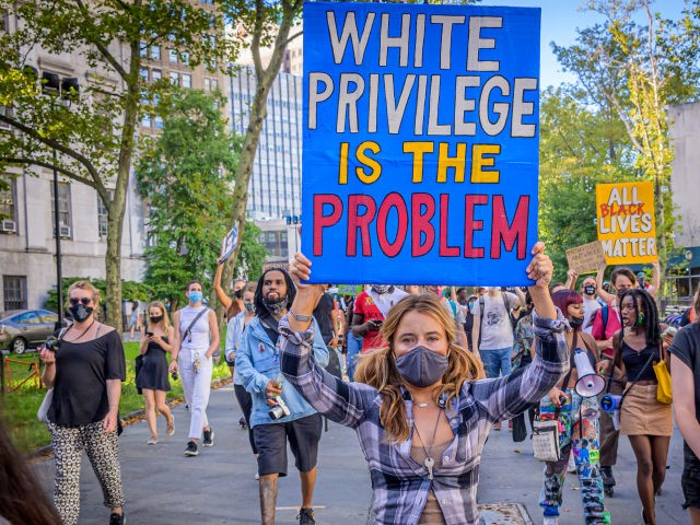 BROOKLYN, NEW YORK, UNITED STATES - 2020/09/05: A participant holding a White Privilege Is The Problem sign at the protest. Brooklynites gathered at Cadman Plaza for a march in the streets of Brooklyn, bringing light to Black Women affected by police violence and to amplify the movement against police brutality …