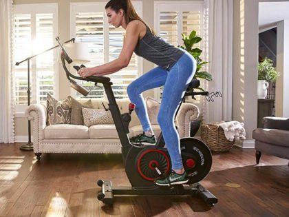 Woman riding Peloton bike