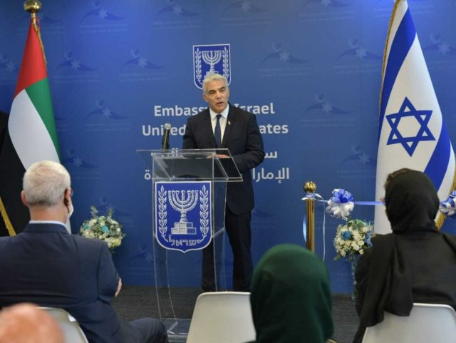 """ABU DHABI, UNITED ARAB EMIRATES - JUNE 29: (----EDITORIAL USE ONLY â MANDATORY CREDIT - """" ISRAELI FOREIGN MINISTRY / HANDOUT"""" - NO MARKETING NO ADVERTISING CAMPAIGNS - DISTRIBUTED AS A SERVICE TO CLIENTS----) Israeli Foreign Minister, Yair Lapid (C) speaks at the opening of Israeli Embassy in Abu Dhabi …"""