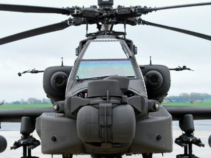 US AH-64 Apache helicopters is parked on the tarmac at Shape Airfield at Chievres Air Base in Belgium, on October 24, 2017. The 1st Cavalry Brigade made a refuelling stop at the base in Belgium on its way to a nine-month rotation in Illesheim, Germany to support Operation Atlantic Resolve …
