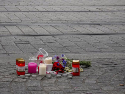 Flowers and candles were laid near the crime scene in central Wuerzburg, Germany, Saturday, June 26, 2021. German police say several people have been killed and others injured in a knife attack in the southern city of Wuerzburg on Friday.(AP Photo/Michael Probst)