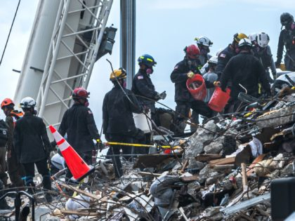 Search and Rescue teams look for possible survivors and to recover remains in the partially collapsed 12-story Champlain Towers South condo building on June 29, 2021 in Surfside, Florida. - The death toll after the collapse of a Florida apartment tower has risen to nine, the local mayor said on …