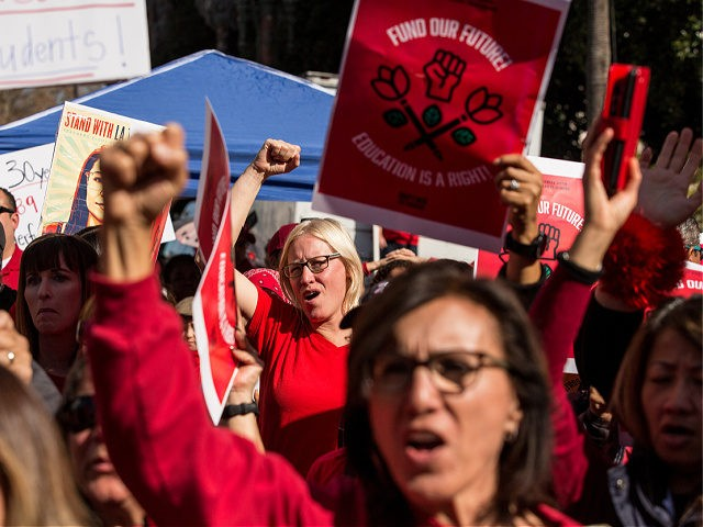 LOS ANGELES, CA - JANUARY 22: Educators, parents, students, and supporters of the Los Angeles teachers strike wave and cheer in Grand Park on January 22, 2019 in downtown Los Angeles, California.Thousands of striking teachers cheered for victory at the rally after it was announced that a tentative deal between …