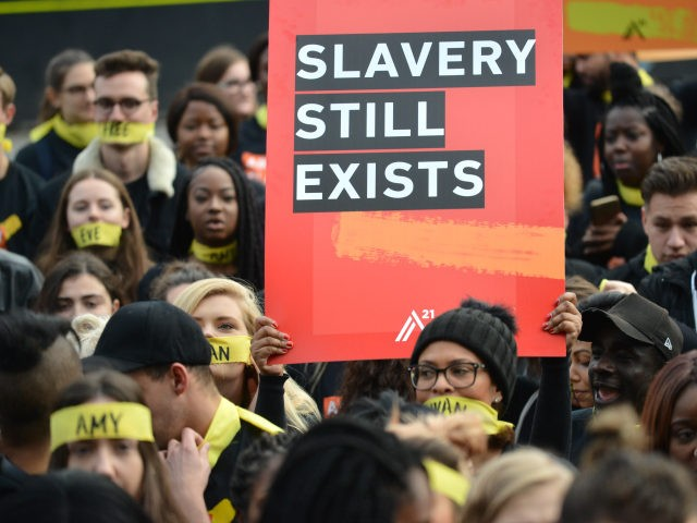LONDON, UNITED KINGDOM - OCTOBER 14: People marching against modern slavery through London wearing face masks representing the silence of modern slaves in forced labour and sexual exploitation on October 14, 2017 in London, England. PHOTOGRAPH BY Mathew Chattle / Barcroft Images (Photo credit should read Mathew Chattle / Barcroft …