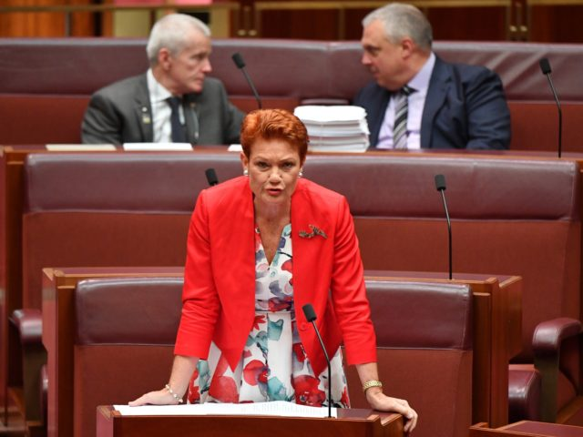 CANBERRA, AUSTRALIA - MARCH 18: Senator Pauline Hanson speaks as Senators Malcolm Roberts (top left) and Stirling Griff (top right) look on during debate of the Fair Work Amendment Bill 2021 in the Senate at Parliament House on March 18, 2021 in Canberra, Australia. SenatorStirling Griffhas issued a statement confirming …
