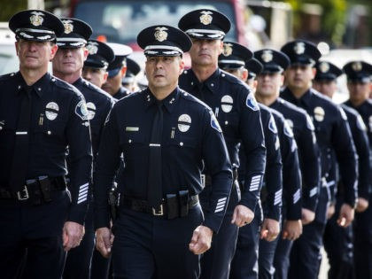 WESTLAKE VILLAGE, CA - NOVEMBER 15: Santa Ana Police Officers leave the service of Sgt. Ron Helus, who was killed Wednesday, Nov. 7, 2018, in a deadly shooting at a country music bar, the Borderline Bar and Grill in Thousand Oaks, Calif., following his memorial service at The Calvary Community …