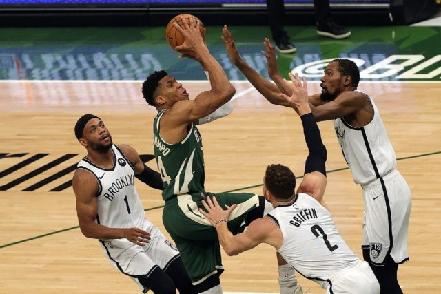Milwaukee's Giannis Antetokounmpo shoots against Blake Griffin and Kevin Durant of Brooklyn in the Bucks' 86-83 NBA playoff victory over the Nets