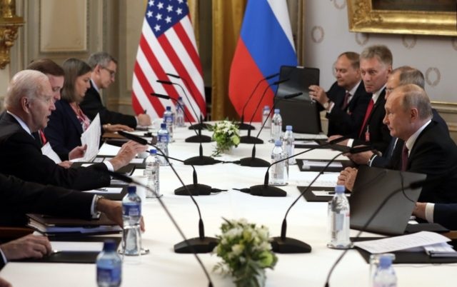 US President Joe Biden (L) told Russian President Vladimir Putin (R) in their Geneva summit that he would not tolerate more attacks on US infrastructure from Russia-based ransomware extortionists