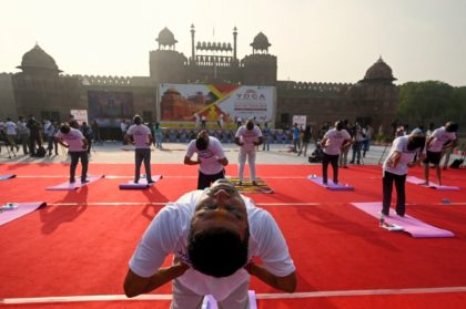 Indians marked International Yoga Day at the Red Fort in New Delhi as the country said it would open up free vaccinations to all adults