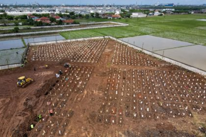 A funeral at a cemetery for Covid-19 coronavirus victims in Jakarta