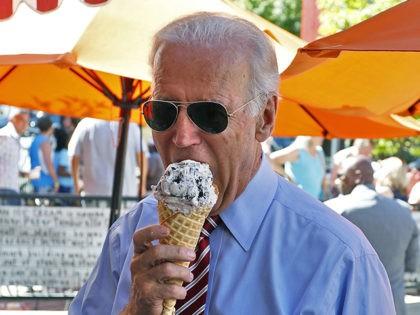 Vice President Joe Biden eats ice cream during a visit to Little Man Ice Cream, in Denver, Tuesday, July 21, 2015. (AP Photo/Brennan Linsley)