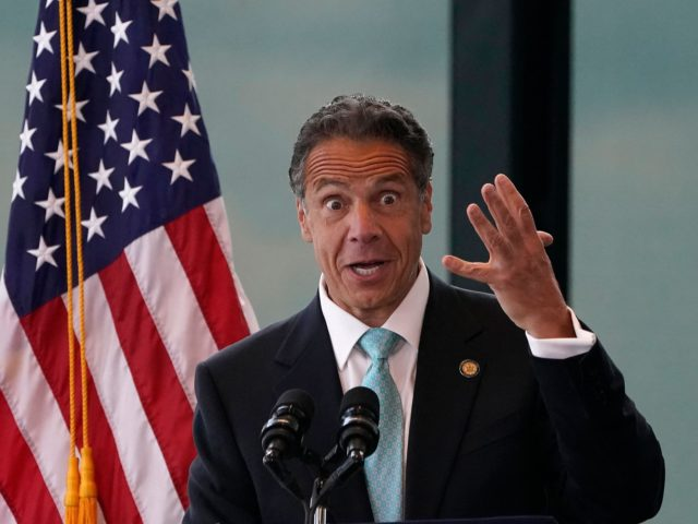 New York Governor Andrew Cuomo speaks during an event to announce that New York will lift 'virtually all' Covid-19 restrictions, after the state cleared the threshold of 70 percent vaccinated, at One World Trade Center in New York on June 15, 2021 (Photo by TIMOTHY A. CLARY / AFP) (Photo …