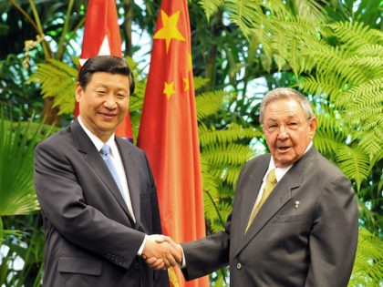 China's Vice-President Xi Jinping (L) shakes hands with Cuban President Raul Castro (R), on June 5, 2011 at Revolution Palace in Havana. Xi is in Cuba on a four-day official visit as part of an international tour that will include stops in Italy and Uruguay. China, Cuba's second largest trading …