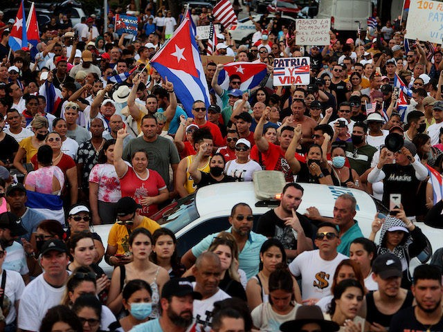 MIAMI, FLORIDA - JULY 11: Protesters gather in front of the Versailles restaurant to show support for the people in Cuba who have taken to the streets there to protest on July 11, 2021 in Miami, Florida. Thousands of Cubans took to the streets across the country to protest pandemic …