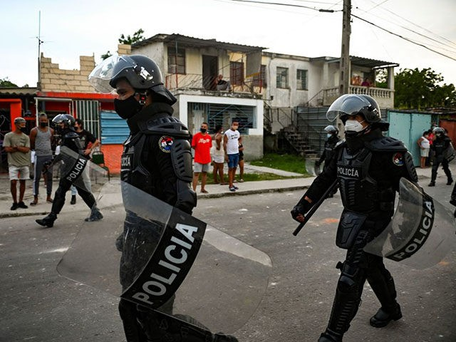 """Riot police walk the streets after a demonstration against the government of President Miguel Diaz-Canel in Arroyo Naranjo Municipality, Havana on July 12, 2021. - Cuba on Monday blamed a """"policy of economic suffocation"""" of United States for unprecedented anti-government protests, as President Joe Biden backed calls to end """"decades …"""