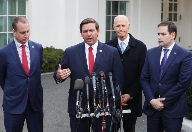 WASHINGTON, DC - JANUARY 22: Florida Governor Ron DeSantis speaks to the media while flanked by (L-R) Rep. Mario Diaz-Balart (R-FL), Sen. Rick Scott (R-FL) and Sen. Marco Rubio (R-FL), after a meeting with President Donald Trump regarding Venezuela on January 22, 2019 in Washington, DC. (Photo by Mark Wilson/Getty …