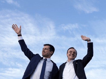 Democratic presidential candidate former South Bend, Indiana Mayor Pete Buttigieg and his husband Chasten Buttigieg wave during a campaign town hall event at Washington Liberty High School February 23, 2020 in Arlington, Virginia. Buttigieg held the event in Virginia to campaign for the upcoming Super Tuesday primaries. (Photo by Alex …