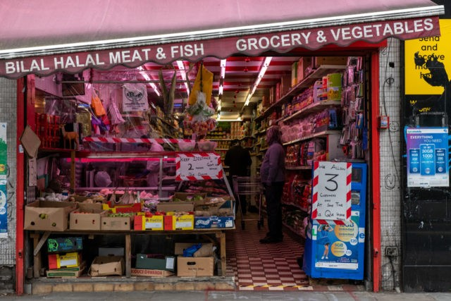 LONDON, ENGLAND - MAY 03: Social distancing signs at a Halal butchers in Lewisham on May 3, 2020 in London, England. The Office For National Statistics (ONS) data analysis released this week on the Coronovirus pandemic found that poor areas of England and Wales are the worst affected. The most …
