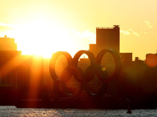 TOKYO, JAPAN - MARCH 24: The sun sets behind the Olympic rings in Odaiba marine park on March 24, 2020 in Tokyo, Japan. Although an official decision is yet to be announced, International Olympic Committee member Dick Pound has said the Tokyo 2020 Olympic Games will be postponed by one …