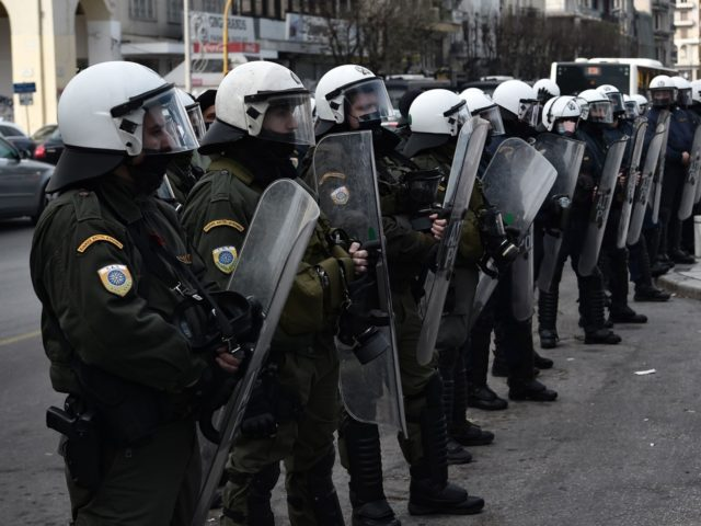 A Greek student confronts Greek riot police during a protest by students against both the ministry of Education and the police who plan to create a dedicated 1,000-strong force to patrol campuses, in Thessaloniki, northern Greece on January 21, 2021. - The operation of Greek universities has been disrupted for …