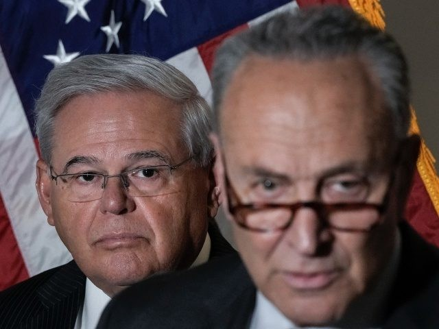 WASHINGTON, DC - MAY 18: (L-R) Sen. Bob Menendez (D-NJ) and Senate Majority Leader Chuck Schumer (D-NY) speak to reporters during a news conference following a policy luncheon meeting with fellow Senate Democrats on Capitol Hill May 18, 2021 in Washington, DC. Schumer and the Democratic Senators took questions form …