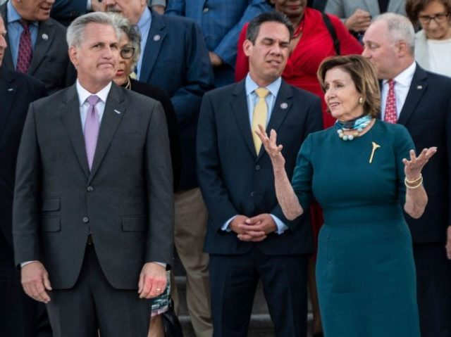 US Speaker of the House Nancy Pelosi (D-CA) (R) speaks with US Representative Kevin McCarthy (R-CA) (L) before a moment of silence by congressional leaders to honor the 600,000 American lives lost to Covid-19 at the US Capitol in Washington, DC on June 14, 2021. (Photo by ANDREW CABALLERO-REYNOLDS / …