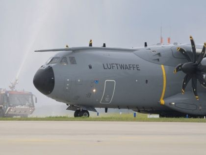 An Airbus A400M cargo plane of the German armed forces Bundeswehr is greeted by water cannons on the tarmac at the military air base in Wunstorf, northern Germany, on June 30, 2021, as German soldiers come back from Afghanistan. - Germany has completed its troop pull-out from Afghanistan, started in …